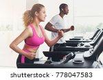 couple run on treadmills. man...   Shutterstock . vector #778047583