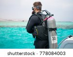 a diver in diving gear is... | Shutterstock . vector #778084003