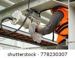 a male technician is doing... | Shutterstock . vector #778230307