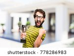 young cool man with a trophy | Shutterstock . vector #778286983
