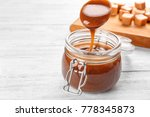 spoon with tasty caramel sauce...   Shutterstock . vector #778345873