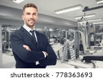 owner of business in his gym | Shutterstock . vector #778363693