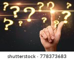 question marks and hand | Shutterstock . vector #778373683
