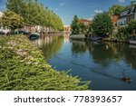 Wide Canal With Brick Houses...