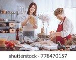 young woman kneading dough... | Shutterstock . vector #778470157