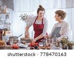 women in kitchen aprons cooking ... | Shutterstock . vector #778470163