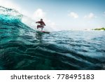 young surfer rides the wave.... | Shutterstock . vector #778495183