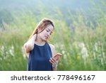 beautyful asian woman use hand... | Shutterstock . vector #778496167