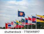 Small photo of ASEAN Economic Community flags, southeast asia countries and sky background