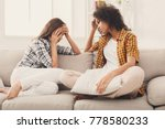 two sad diverse women talking... | Shutterstock . vector #778580233
