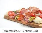 sliced ham on cutting board | Shutterstock . vector #778601833
