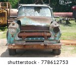 Abandoned And Rusting Car In U...