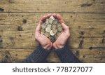 man hands holding a heap of... | Shutterstock . vector #778727077