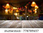 closeup top wood table with... | Shutterstock . vector #778789657