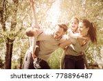 parents carrying their children ... | Shutterstock . vector #778896487