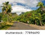 girl riding a bicycle through...   Shutterstock . vector #77896690
