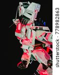 Small photo of ODAIBA, JAPAN - 25 November 2017. Unicorn Gundam with in both Unicorn mode and Destroy Mode at Diver City background dark sky. The real size model of Gundam robot in Odaiba, Tokyo.