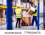 young workers in a warehouse. | Shutterstock . vector #779024473