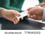 notary giving business card to... | Shutterstock . vector #779045353