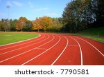 Runners racetrack going left, surrounded by trees - stock photo