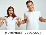 cheerful young couple in white... | Shutterstock . vector #779072077