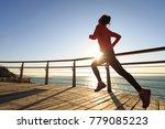 sporty fitness female runner... | Shutterstock . vector #779085223