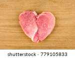 raw meat in the shape of a... | Shutterstock . vector #779105833