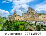 Small photo of View of rooftops of the Italian city Matera with san pietro caveoso and madonna de Idris churches