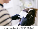 the hairdresser in the beauty... | Shutterstock . vector #779133463