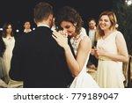 bride leans to groom's shoulder ... | Shutterstock . vector #779189047