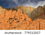 Small photo of Nepal - Upper Mustang - Mustang Caves or Sky Caves are man-made caves of over 2.000 - 3.000 years old. Near Dhakmar village.