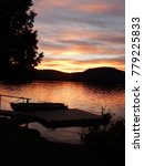 Small photo of Sunset falls over a rowboat on Blue Mountain Lake in New York's Adirondack Mountains.