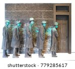 Sculpture Of Men Lined Up...