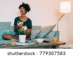 happy young black woman sitting ... | Shutterstock . vector #779307583