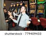 good looking man celebrating he ... | Shutterstock . vector #779409433