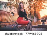 young elegant woman sit in the... | Shutterstock . vector #779469703