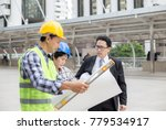 team of engineers working... | Shutterstock . vector #779534917