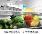 refrigerator with fresh... | Shutterstock . vector #779595583