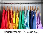 colorful clothes on hangers in... | Shutterstock . vector #779605567