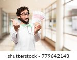 young doctor man with euro bills | Shutterstock . vector #779642143
