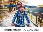 young couple enjoying in a bike ...   Shutterstock . vector #779647303