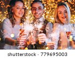 friends celebrating christmas...   Shutterstock . vector #779695003