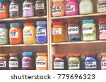 assortment of glass jars on... | Shutterstock . vector #779696323