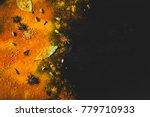 assorted spices on dark black... | Shutterstock . vector #779710933