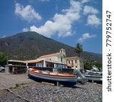 Small photo of Lingua, Salina Island, Italy - July 18 2017: Peaceful view with colorful fishing boats on a pebbly beach and volcanic mountain in the background in the village of Lingua in Salina Island, Sicily