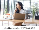 asia woman working with laptop... | Shutterstock . vector #779767537