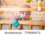 one curious caucasian infant... | Shutterstock . vector #779840473