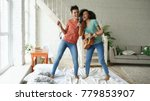 mixed race young funny girls... | Shutterstock . vector #779853907