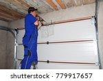 contractor installing garage... | Shutterstock . vector #779917657