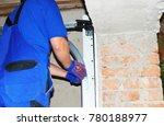 contractor installing garage...   Shutterstock . vector #780188977